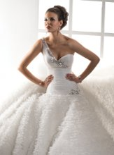 Starla Exquisitely modern, this style features tulle draped across the shoulder trimmed with handmade petals and stunning beaded embellishments. The slightly dropped waist transitions into a ruffled tulle skirt providing a soft textured look.