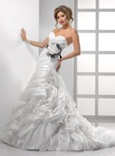 Dion - ASM3569 Bewildering romance is captured in this Vicenza Organza, dropped waist gown featuring sideswept bustles down the skirt and back train. A detachable belt with extravagant horsehair bow, handmade flowers, and Swarovski crystals convey modern luxury. Fitted A-line gown with sweetheart neckline and finished with a corset closure and bubble hem.