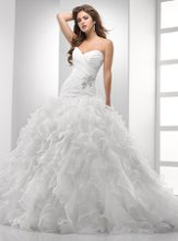 Chrystelle - VSM7142 Glamour and fantasy combine in this Chic Organza ball gown. The asymmetrical bodice features a glimmering Swarovski crystal embellishment at the side waist and transforms into frothy layers of ruffled frills trimmed with fluted edging. Sweetheart neckline with corset closure.