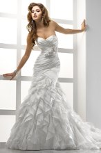 Sloan - JSM1480BB Asymmetrically pleated Valencia Organza forms a body-shaping silhouette and, along with tulle and Point d'Esprit, creates a frenzy of ruffled frills that cascade down the flared skirt. Fitted A-line gown with sweetheart neckline and corset closure. Includes a detachable beaded satin ribbon belt or Valencia Organza belt with handmade flowers, both featuring Swarovski crystals.