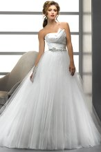 Joanna - 71503 Sophisticated romance presented in a tulle and satin ball gown featuring an artfully draped, asymmetrical bodice and a Swarovski crystal waistband. Finished with corset closure.