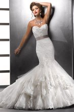Tenille - 71743 For the uncompromising bride looking for romance, sophistication and elegance together in a fashion-forward style, this fit and flare of embellished lace and tulle with sweetheart neckline features a detachable grosgrain ribbon belt and signature corset back closure. Available with lace jacket.