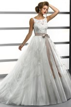 Gigi - 711643 This modern fairytale ball gown of Crystal Tulle features a lace bodice with illusion bateau neckline and a full skirt with dramatic draping. Finished with grosgrain ribbon belt, inner corset and button closure.