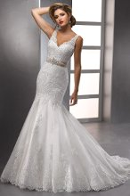 Charlotte - 712603BB A couture treasure, this richly imbued, yet delicate fit and flare features an illusion V-neckline and hand beaded lace motifs scattered throughout. Available with a glamorous Swarovski crystal motif on grosgrain ribbon belt and is finished with covered button over zipper closure.