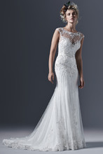 Beckett  Glamorous tulle paired with intricate pearls and embellishments create this perfectly romantic sheath wedding dress, with a stunning illusion bateau neckline and back, glittering with Swarovski crystals. A satin belt with crystal embellishment accents the waist. Finished with covered buttons and zipper closure.