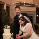 130x130 sq 1489125130511 bride and groom cutting the cake