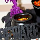 Halloween-themed candy buffet created by Haloe Events.