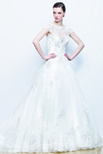 IVONNE Sweetheart A-line gown in tulle with intricate embroidery and an illusion lace bateau neck with cap sleeves.