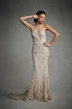 Enzoani July Modern elegance and touches of Old Hollywood glamour are epitomized in this floor-length gown with flattering sweetheart neckline, delicate beaded spaghetti straps, beaded embroidery accents on the bodice and skirt, and gorgeous low back with invisible zipper.