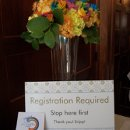 130x130_sq_1321216517003-registrationtableflowersbyforgetmenotflorist2
