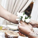 130x130 sq 1311706862343 wristflowers