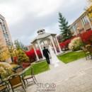 130x130 sq 1385154604438 bride groom walking to gazeb