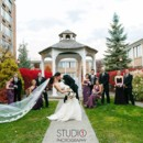 130x130 sq 1385154722396 gazebo groom kissing brid