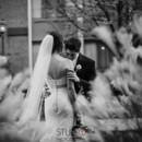 130x130 sq 1385154737325 groom kissing shoulde