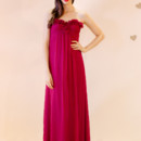 Bisou Strapless empire waist gown with rose detail at center of bust. Available in multiple colors!