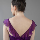Parkview Scoop neckline with criss-cross strap and ruffles.