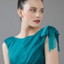 Seaside Bateau neckline dress with bow shoulder and asymmetrical draped skirt