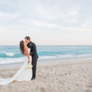 130x130 sq 1485875744716 bride  groom on beach