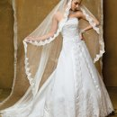 1155W Strapless satin wedding dress split front and beaded lace trim.
