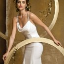 6165W Chiffon over satin bias cut wedding dress with a drape neckline, empire waist, rhinestone cris-cross straps, and a godet bottom with a chapel length train.