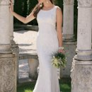 2157W Fully beaded and lace wedding dress with scoop neck, empire waist, princess seams, and a chapel length train.