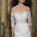 Style No. 41790-8241W  <br /> Capture the quintessential aura of soft elegance in this vintage inspired wedding dress with textured organza pleating. The off the shoulder jacket with three-quarter sleeves made in luxurious lace adds the perfect touch of swoon-worthy allure. Other design features include a button back and subtle lace detail along the skirt area.