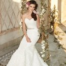 Style No. 42426_1441W  <br /> This strapless wedding dress is the perfect complement to enhance that dreamy and romantic ambiance. Not to mention its style and silhouette alone are must-have elements that make for the IT wedding gown to own. Style factors that make this look so special include a ruched, chiffon fabric with a lovely sweetheart neckline and magnificent mermaid skirt comprised in astounding rosettes.