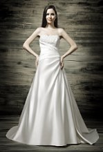 41770-D31068 This elegant satin wedding dress has a beautifully beaded bodice and side draping with and envelope panel back.