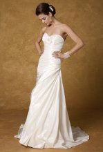 5085W Strapless pleated A-line wedding dress with bow and beaded details.