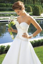 4017W Satin wedding dress with metallic and beaded bodice, box pleats, with chapel train.