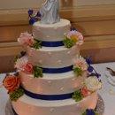 130x130_sq_1361660529803-cakepeachorgclustersflwrsbluribbon