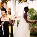 130x130 sq 1326673879048 weddingrevdebswithhandheldbowlcoupleinbackground