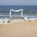 130x130 sq 1419797340352 beach wedding setup arch charis sand ceremony tabl