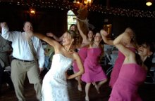 220x220 1314804585845 bridedancingwithbridesmaids