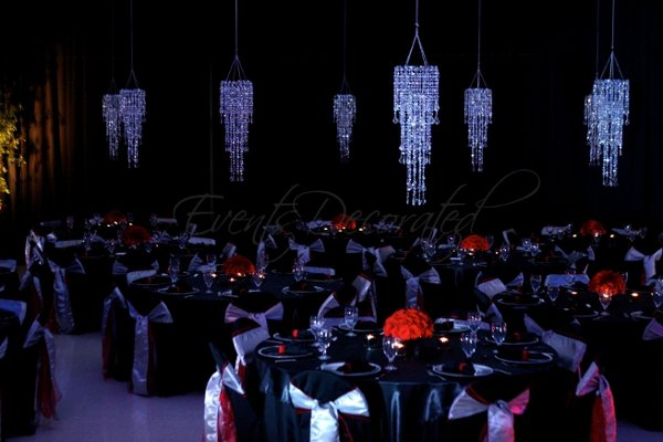 Black red silver white candles centerpiece centerpieces chairs indoor
