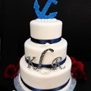 Tying the Knot - Sugar anchor, Navy ribbon and fondant 'ropes' with rhinestone monograms.