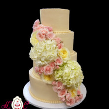 220x220 sq 1421772122565 ivory 4iter buttercream with fresh florals 1200