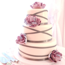 220x220 sq 1443109543459 ribbon wrapped wedding cake with multi color purpl