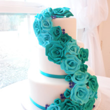 220x220 sq 1443109694397 teal rose cascade wedding cake 1200