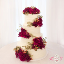 220x220 sq 1475071611489 four tier rustic buttercream with fresh magenta fl