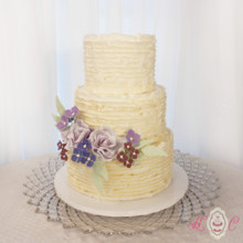 220x220 sq 1475075080326 white buttercream ruffles and purple sugar flowers
