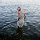 130x130 sq 1485555553817 bride wading in water