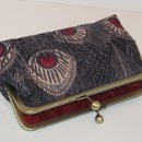 Liberty of London Hera Peacock clutch in a soft wool challis done in shades of taupe on a black background with red peacock centers. I've choosen to line this clutch in an exotic black cherry silk dupioni which matches the peacock centers, giving this clutch a very dramatic look. I've lined the inside of this clutch purse with a soft yet firm stablizer and thick batting. This gives your clutch extra padding and protection for your valuables such as ipod, cell, camera, eye glasses ect. $65.00