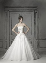 8483 Gown features beading and florets. Also available in tea length