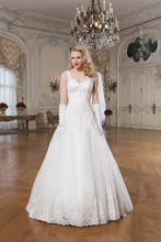 8763 Venice lace ball gown embellished by a V-neck