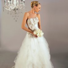 3166 Aurelia A romantic ball gown with nature inspired details. This beautiful bodice has Intricate rose petals embossed with Swarovski crystals and is paired with a flowing tulle skirt.
