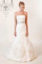 3164 Clarice A beautiful, strapless, mermaid gown with a romantic ruched organza overlay. This gown is detailed with a Swarovski crystal belt and the skirt is adorned with delicate glitter tulle.