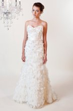3169 Rosalie A romantic, whimsical gown with a delicate overlay accented with floret details and silk sash to accentuate the waistline.