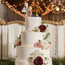 220x220 sq 1528470559 a7bf5ccdd681704d 1485284269973 white cake with roses