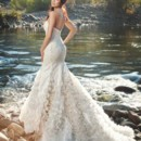 Spring 2014 Alectra - Back Dramatic strapless mermaid gown with built-in corset featuring a draped chiffon bodice over silk duchess. Embroidery appliques diffuse into a cascade of silk satin organza ruffles.